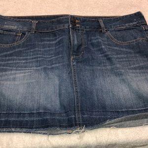 Frayed hem mini jean skirt.